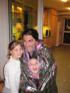 Dan Taylor (with a weird cape on) with his cutie-pie daughters Evie (on the left) and Alice (on the right).