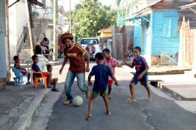 Taj playing footbal with children