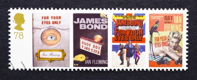 "Postage stamp printed in United Kingdom showing images of covers of ""James Bond, For Your Eyes Only"", novels by Ian Fleming"
