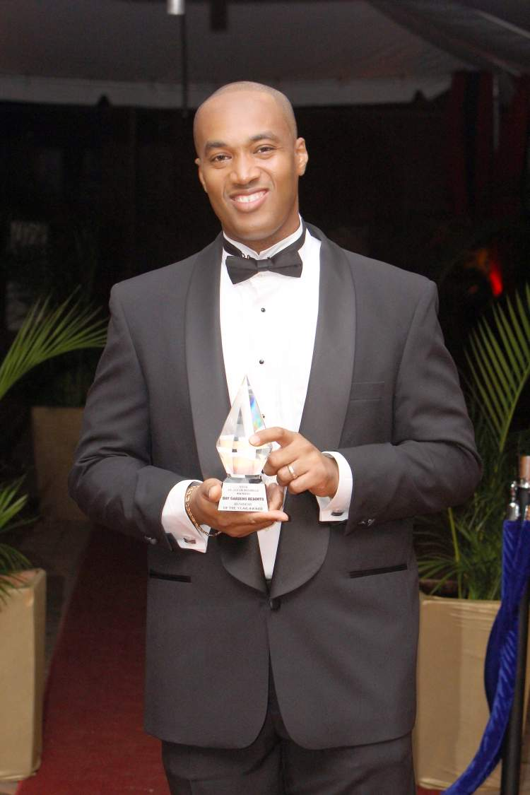 Sanovnik Destang with 2014 St. Lucia Business of the Year Award for Bay Gardens Resort
