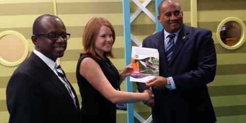Pippa Jacks of TTG presents a copy of the European Industry Trends & Insight Report 2014 to CTO Chairman Richard Sealy with CTO SG Hugh Riley (L) looking on