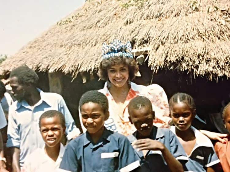 Giselle on a visit to The Gambia, Africa, at an SOS village during her reign as Miss World 1987