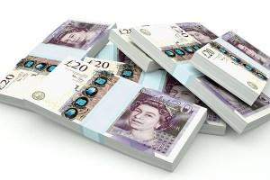 Piles of UK Money isolated on white background
