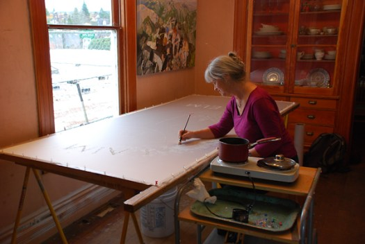 Kristen Gilje applying wax to lettering
