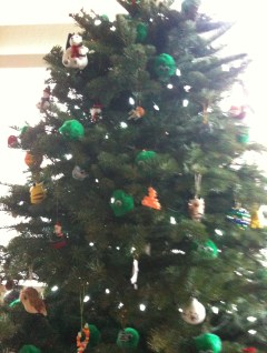 Photo of a Christmas Tree with eclectic ornaments.