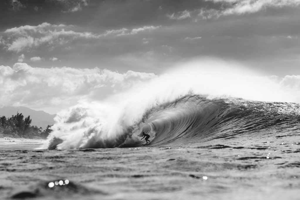 unrecognizable surfer in wavy sea