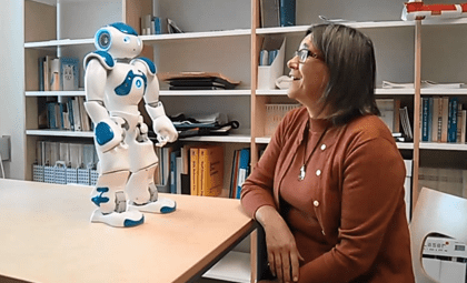 Kristiina with Finnish news-reading robot