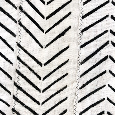 vintage mudcloth throw with a chevron pattern