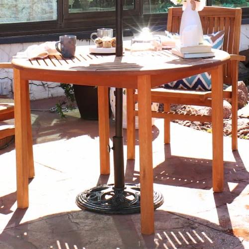 sunnydaze heavy duty cast iron outdoor patio umbrella base stand holder 18 1 umbrella base