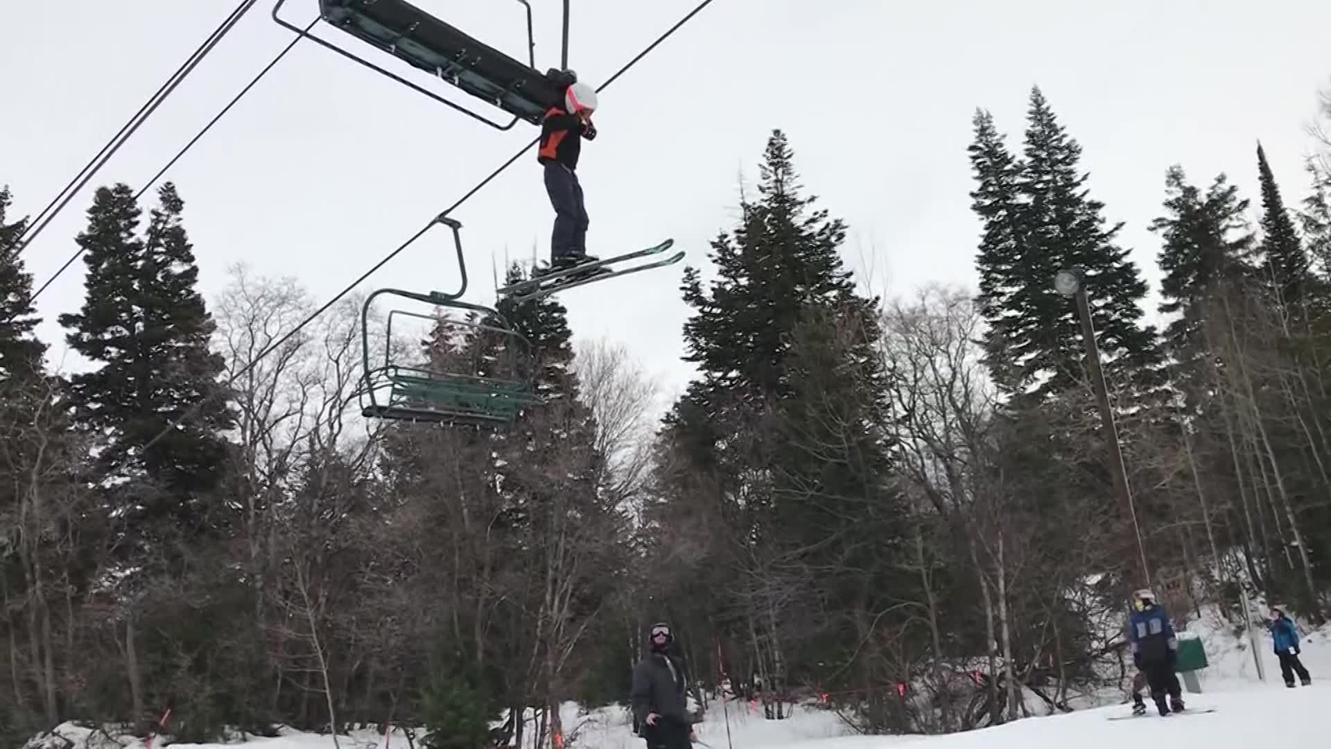 boy stuck on chairlift_469296