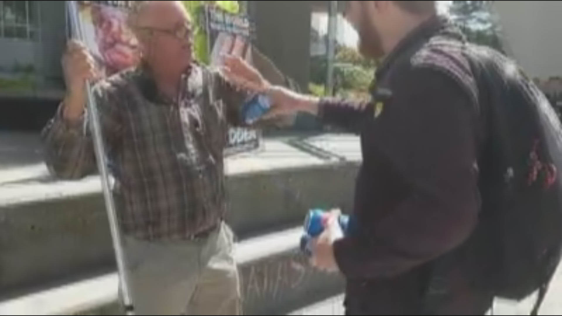 VIDEO: San Francisco State student attempts to quench protester's