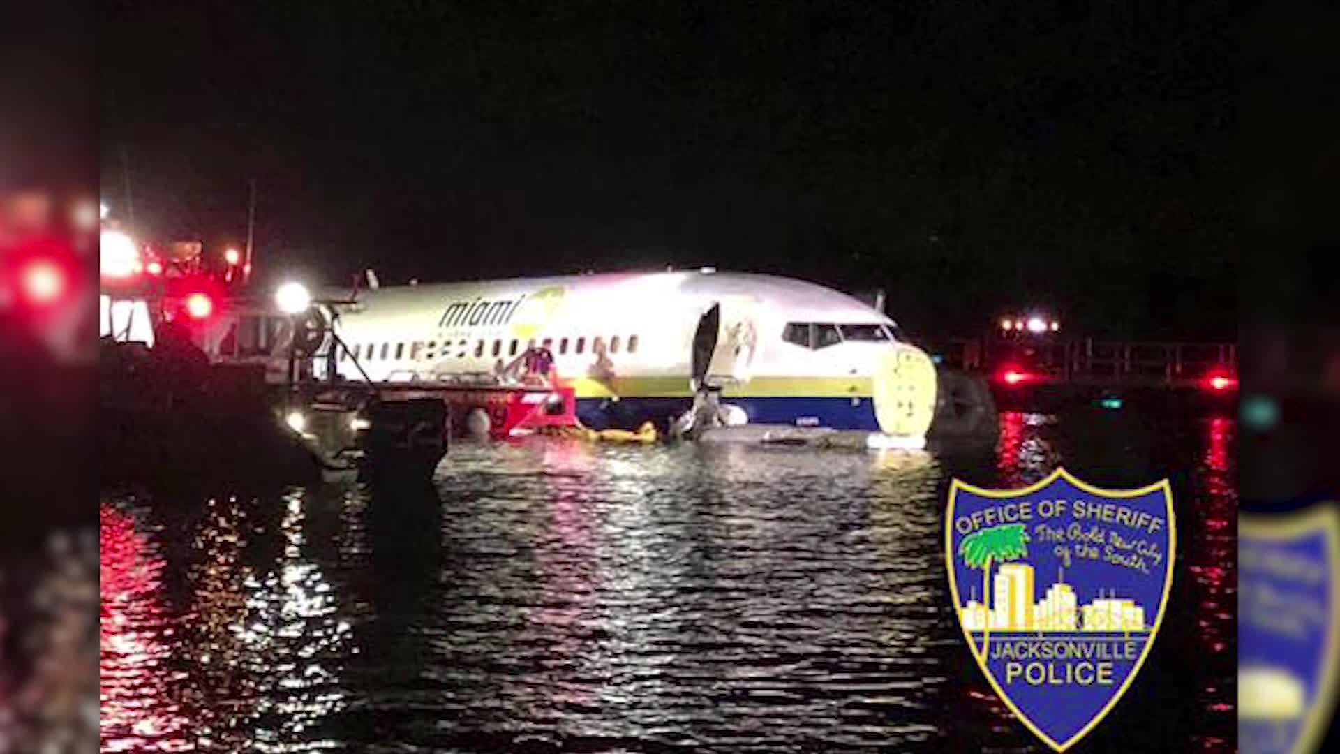 Plane in river: Passenger climbs onto the wing