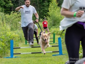 A runner clears some hurdles at Jump! Duck! Run! 2018