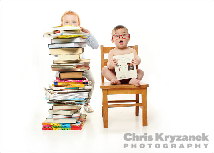 Girl and baby wearing glasses with books photo
