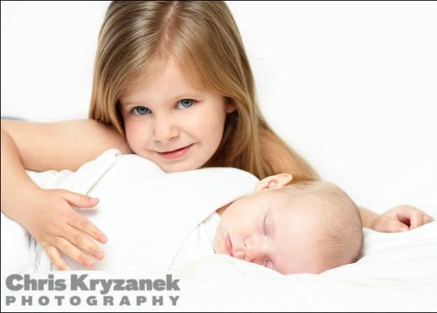Sister and baby sister sleeping baby photo