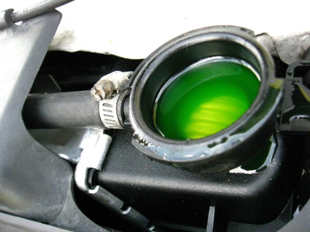 medium resolution of green antifreeze in a car radiator