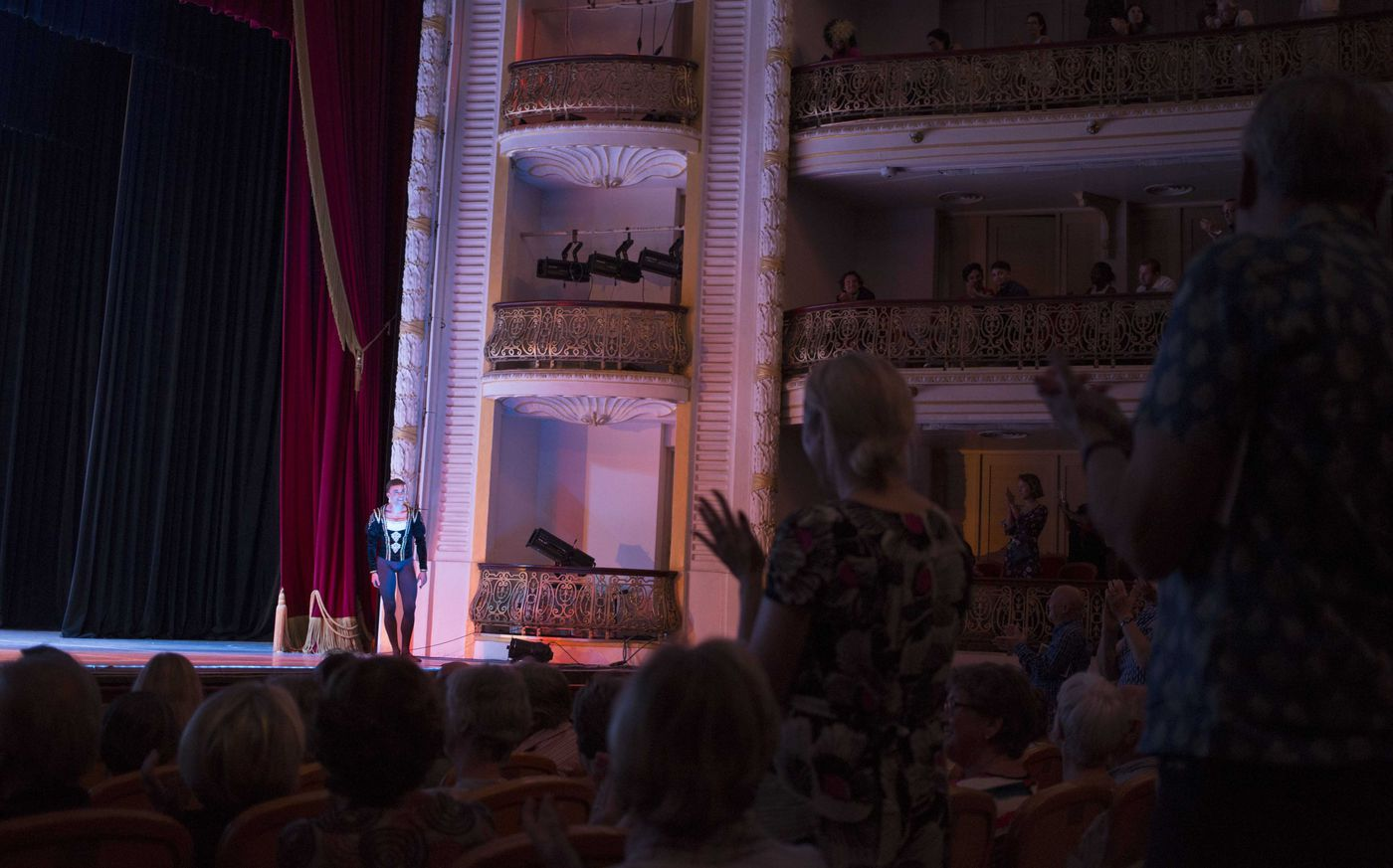"In this Oct. 29, 2018 photo, Cuban expatriate ballet dancer Taras Domitro receives a standing ovation at the grand theater in Havana, after his return to Cuba. ""This is the correct path,"" said Domitro, who defected during a tour of Canada in 2007, one of the highest-profile departures from Alonso's company. ""We're talking about ballet, we have nothing to do with politics."" (AP Photo/Desmond Boylan)"