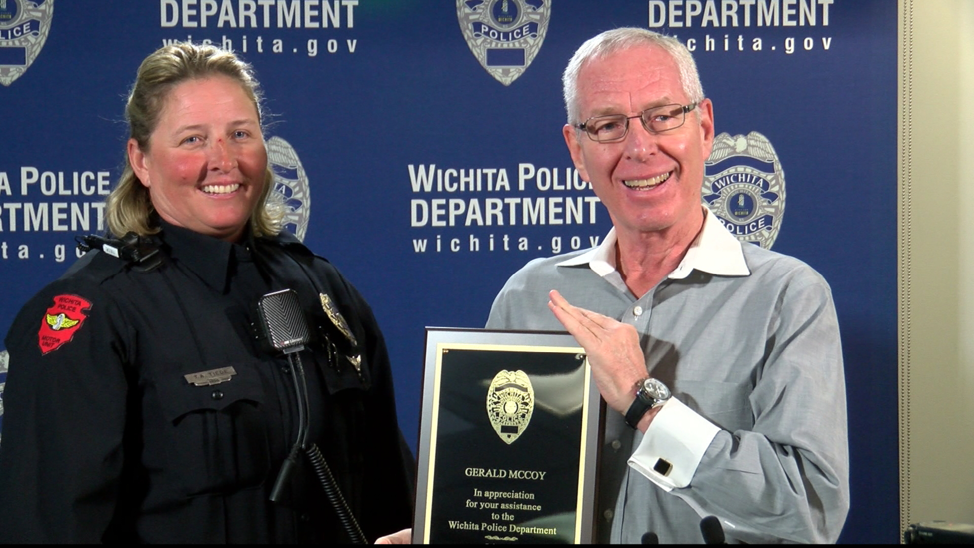 Police department presents award to two men for helping