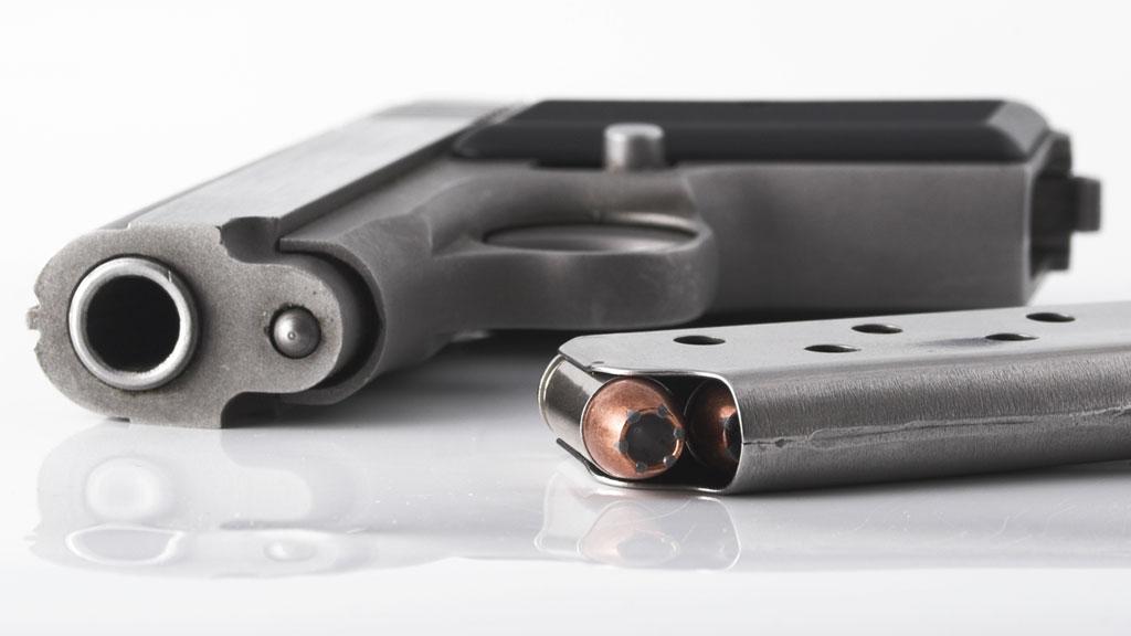 Gun-on-white-hand-gun-generic-file-MGFX_1551494527690.jpg