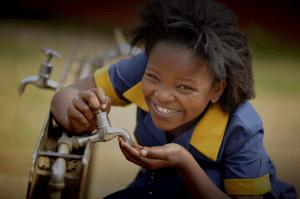 Kagiso Shanduka Trust (KST), South African rural school girl drinking water