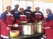 Learners and parents from Reitumela Primary School in their newly built eating and kitchen area