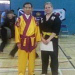 Martial Arts Grandmaster standing beside student