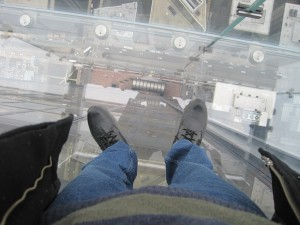 Standing on the glass ledge