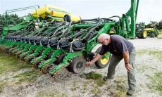Farmer Mick Minchow takes a look at the fine components of his John Deere planter on Monday, June 20, 2016, at his farm in Waverly, Neb. Lincoln Journal Star via AP Kristin Streff