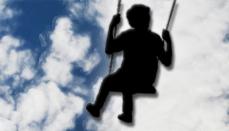 Child in Swing