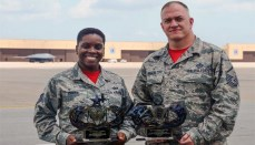 Tech. Sgt. Staci Cooper and Master Sgt. Richard Rogers proudly display their Air National Guard-level awards at Whiteman Air Force Base, Mo., July 7, 2017. Cooper and Rogers won the aviation resource management non-commissioned officer and senior non-commissioned officer of the year award for 2016.