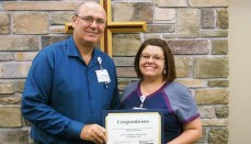 Hylee Thomas (right) receives the Wright Memorial Hospital Employee of the Quarter Award for second quarter 2017 from Gary Jordan, CEO
