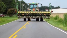 Tractor on Road with Farm Implement