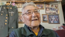 Retired Sgt. 1st Class Sam Jackson, who served in the Alaska Territorial Guard during World War II, poses for a photo inside his home in Kwethluk, Alaska, Sept. 23, 2017. Jackson and more than 6,300 native Alaskans voluntarily joined the territorial guard to defend their homeland against a potential