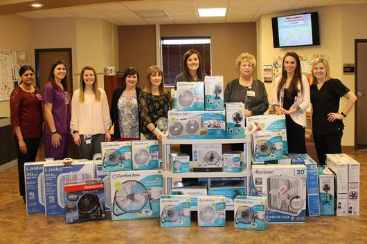 CCMH diagnostic and therapeutic staff and CCMH Rewards & Standards Team members. 44 fans were collected and donated to HELP Services.