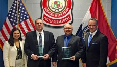U.S. Attorney Timothy Garrison (right) and Assistant U.S. Attorney Ami Harshad Miller (left) present the award to Detectives Larry Roller and Charles Root.