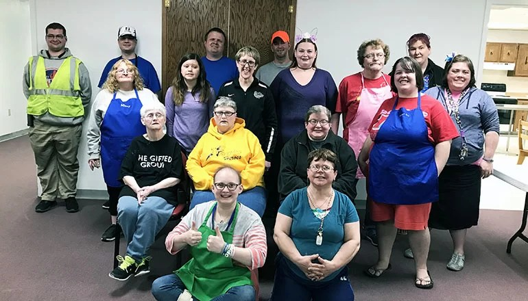 Families and Friends of the Developmentally Disabled attend cooking class