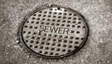 Sewer Line Cap in Street