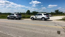 State Patrol Vehicles on Highway as authorities search for Diemel brothers