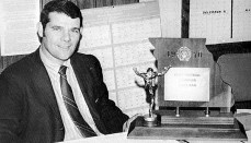 Bob Fairchild posing with 1970 State Football Championship Trophy