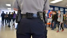 Officer in school building carrying weapon