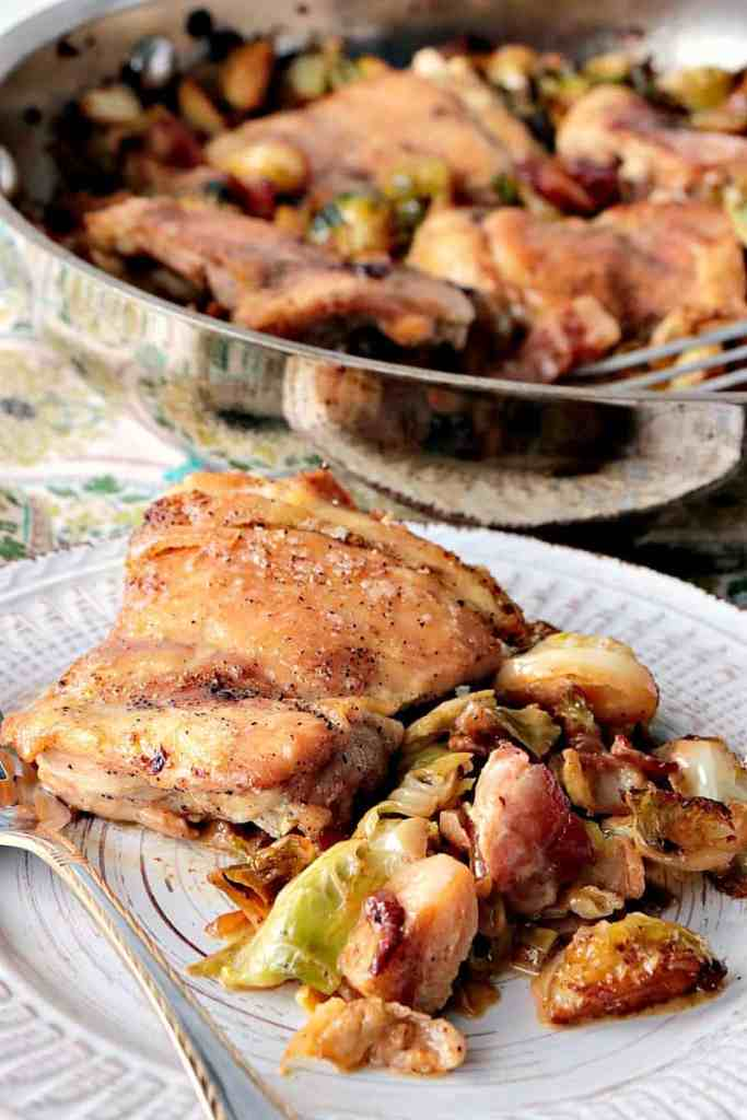 Skillet Chicken Thighs with Brussels Sprouts & Bacon on a plate. - www.kudoskitchenbyrenee.com