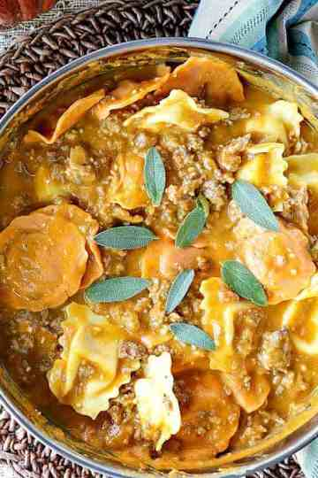 Easy Ravioli with Pumpkin Sausage Vodka Sauce is a proof positive that serving pumpkin for dinner is always a winner! - kudoskitchenbyrenee.com