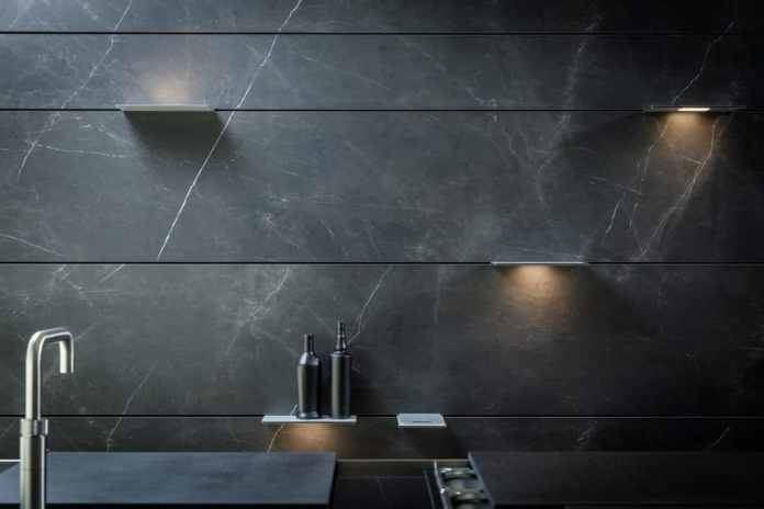 The narrow, vertical lines are barely perceptible in the aesthetic front of the kitchen back wall THE WALL. The current-carrying rails can per
