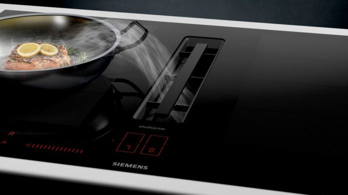 For comparison: with the flush built-in cooktop extractor and the black anodised grease filter, the inductionAir cooktop approaches the minimalist BORA version with a trigger. (Photo: Siemens Hausgeräte)