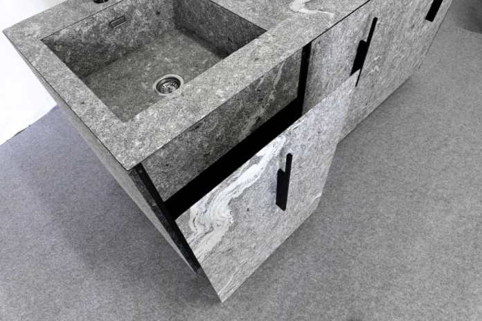 Stone on stone - even the panels of the sink, the fronts of the inner drawers or the tall cupboard are wrapped in stone.  (Photo: MCR)