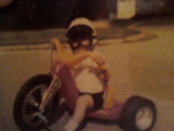 KSN Ken, age five or so, riding a Big Wheel