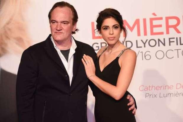 Квентин Тарантино и Даниэла на премьере фильма *Катись!*