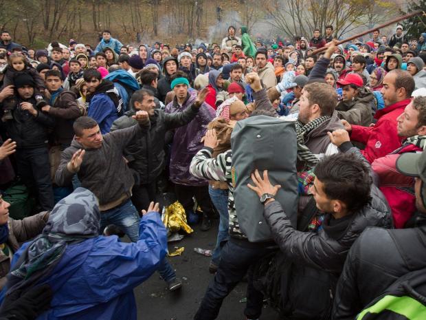 26-Migrants-scuffle-AP