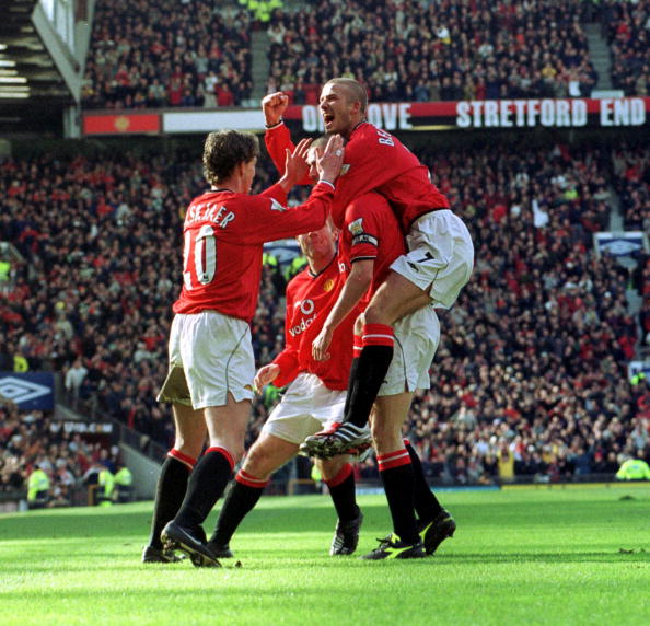 Roy Keane of Manchester united celebrates with tea