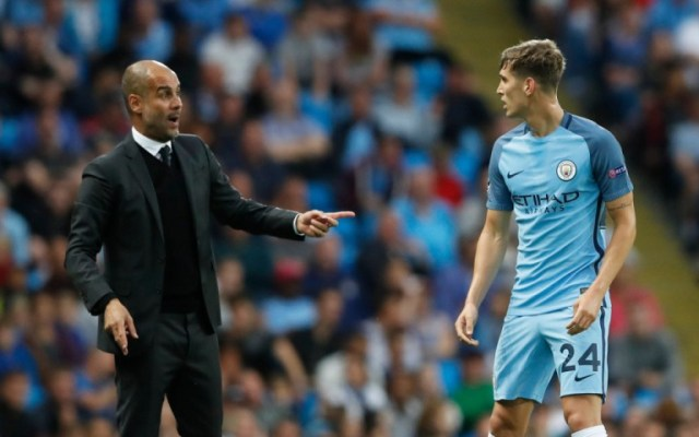 Football Soccer Britain - Manchester City v Steaua Bucharest - UEFA Champions League Qualifying Play-Off Second Leg - Etihad Stadium, Manchester, England - 24/8/16 Manchester City manager Pep Guardiola speaks to John Stones Action Images via Reuters / Carl Recine Livepic EDITORIAL USE ONLY.